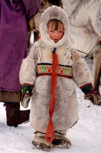 a young Komi girl dressed in traditional reindeer skin clothing | yamal, western siberia, russia