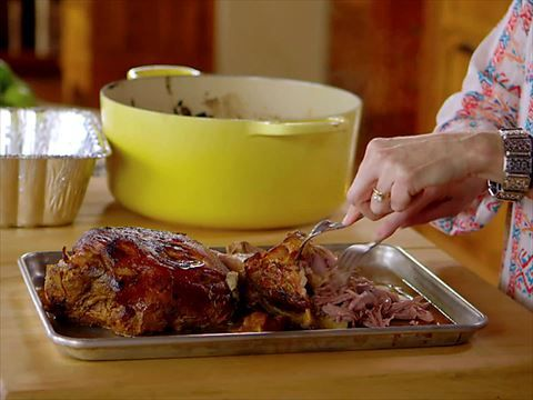 After cooking six hours, Ree's pork shoulder is tender and ready to shred.