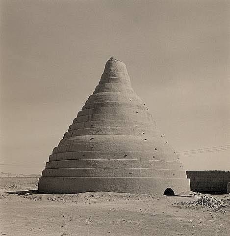 Lynn Davis | Ice House | Iran Ice houses or icehouses are buildings used to store ice throughout the year, commonly used prior to the invention of the refrigerator. Some were underground chambers, usually man-made, close to natural sources of winter ice such as freshwater lakes, but many were buildings with various types of insulation.