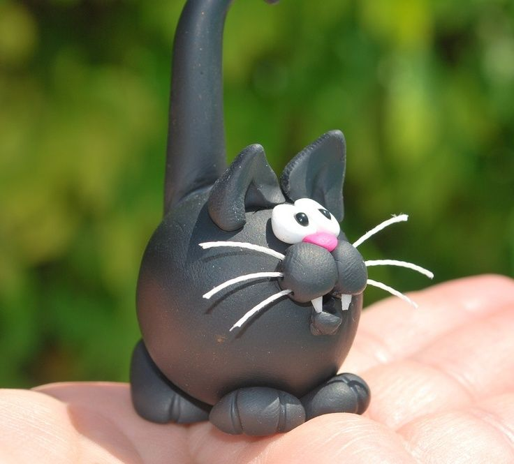 Reminded my of Katy...lol polymer clay cat