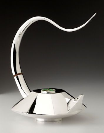 Michael and Maureen Banner, Silversmiths. 9 Sided contemporary teapot. Sterling silver with Cloisonne enamel lid.