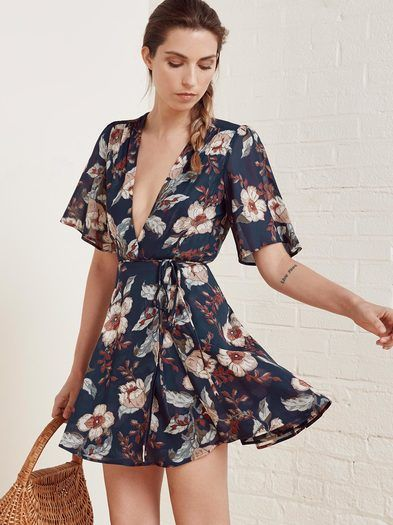 A good excuse to twirl. This is a fit and flare, wrap dress with a deep v neckline, belted waist and drapey sleeve.