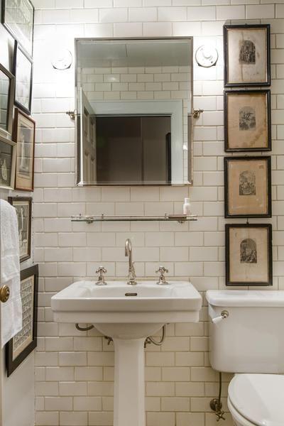 Small tiny compact bathroom, white tile