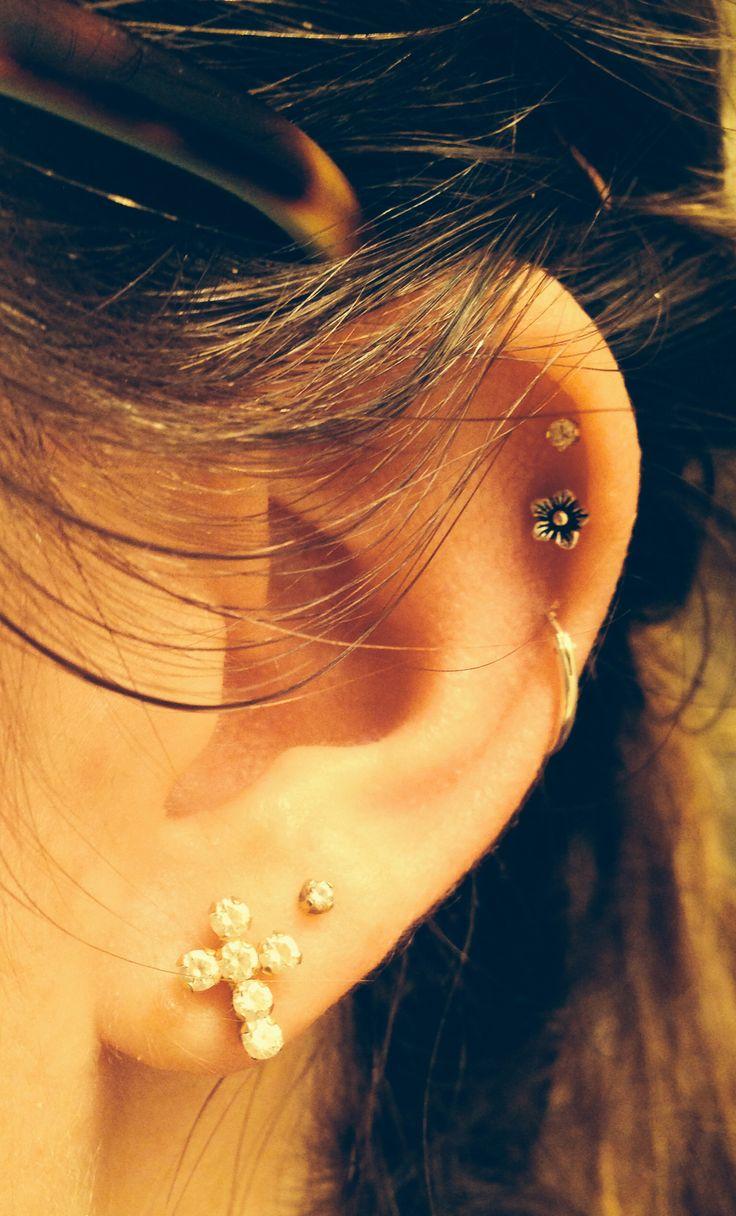 triple cartilage ear piercings with hoop, flower, cross ...
