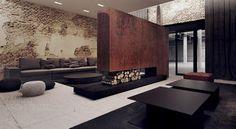 architecture intérieure moderne dans le salon avec cheminée double face en acier Corten, canapé gris, mur de brique et tapis noir