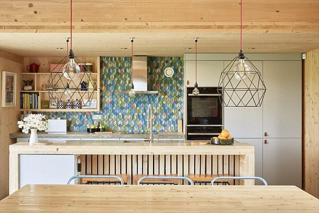 The home was built from timber shipped all the way from Austria on the back of a truck, an...