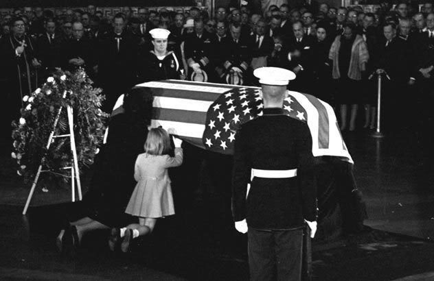 Jackie & Caroline Kennedy kneeling at Kennedy's casket in the U.S. Capital.