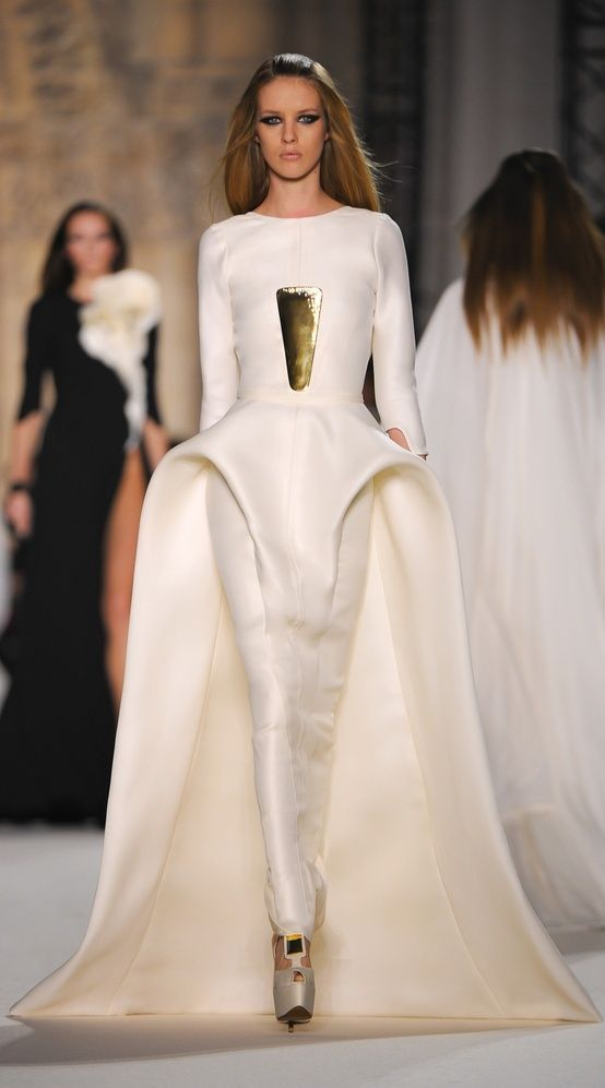Stephane Rolland, future fashion, white dress, futuristic clothing, gold, future girl, futuristic style, fashion girl,model,futuristic dress by FuturisticNews.com
