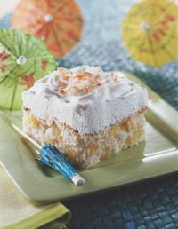 Pina Colada Dump Cake - Only four ingredients: Angle food cake, crushed pineapple, Cool Whip and toasted coconut.