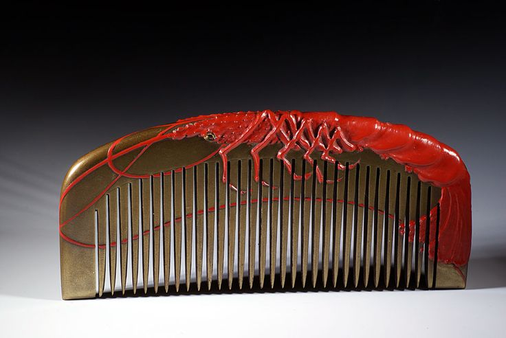 Rare Japanese kushi comb depicting a cinabar red lobster on a gold background…