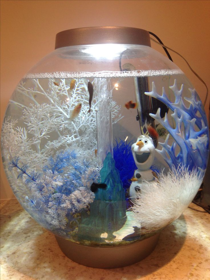 Reef biorb with Disney Frozen ornaments , a Christmas fish tank .