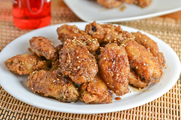 This Korean fried chicken wings coats the wings in tempura flour batter before frying. They are then tossed in a mix of garlic, soy sauce, sugar and mirin.