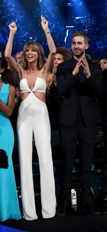 """Taylor Swift and Calvin Harris Style  While we admit Taylor's single-girl style was sexy — and lasted years, people, years! — it's gotten even more daring with Calvin in the picture. Aside from her revealing Balmain jumpsuit, the """"Bad Blood"""" video is full of cutout styles, and her 1989 tour is hotter than ever."""
