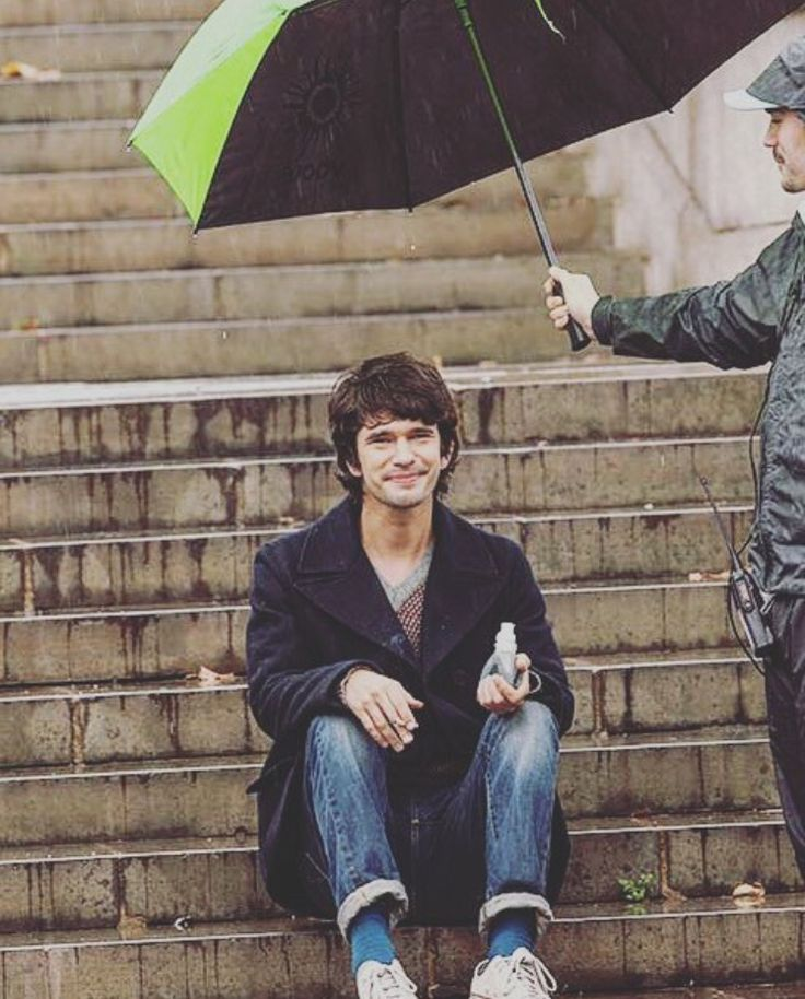 """Look I'm Ben-Adorable-Whishaw and I'm sitting in the stairs while someone else's holding my umbrella because and I am too cute. Did I say I am so adorable?"""