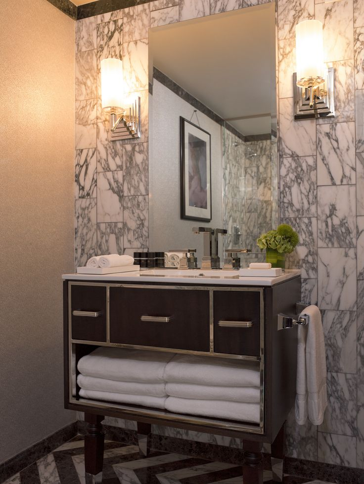 10 design ideas to steal from hotels 1920s bathroom for Bathroom design 1920s house
