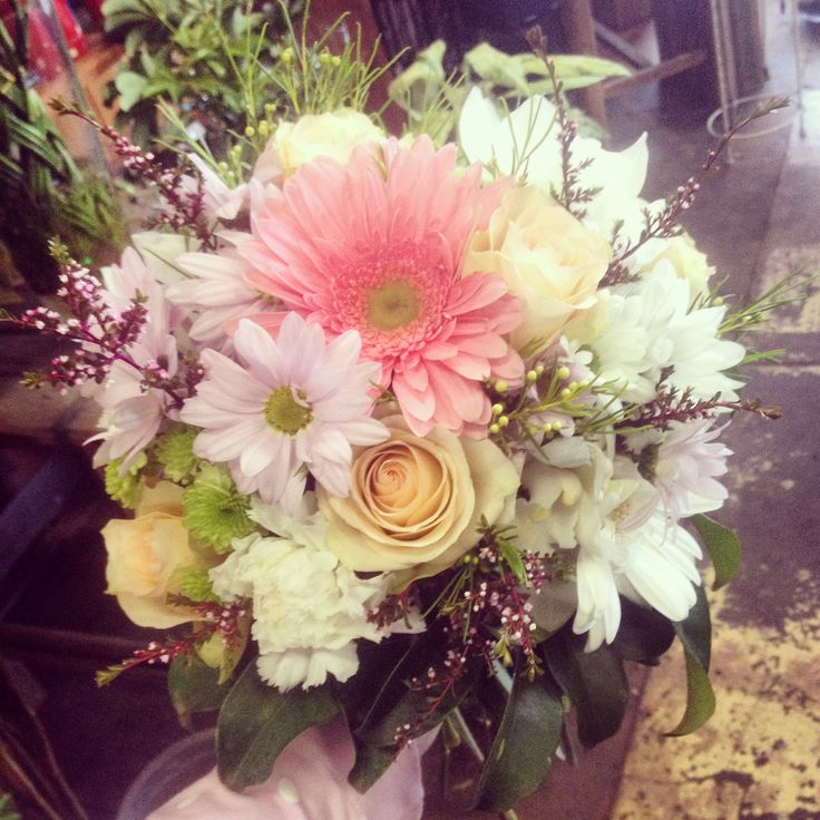 Floral posy with chrisy, gerbera, sim carnation, cymbidium blooms, roses, thryp and wax