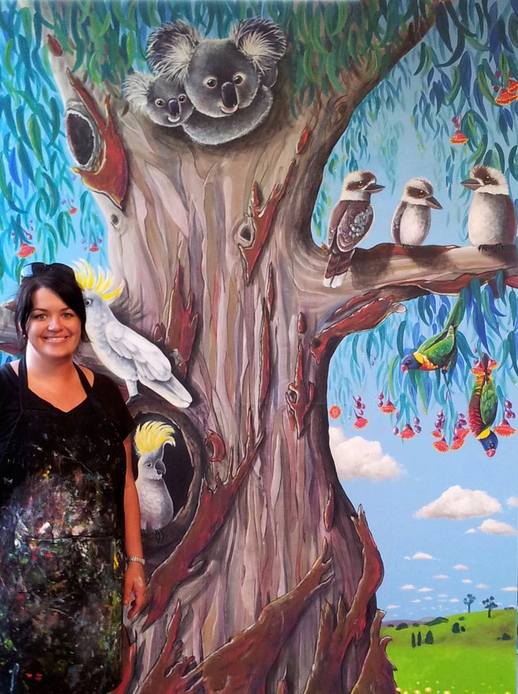 Artist, Selinah Bull standing beside the finished 'Gum Tree' Mural.  Designed and painted for Kookaburra Early Learning Centre, NSW Australia