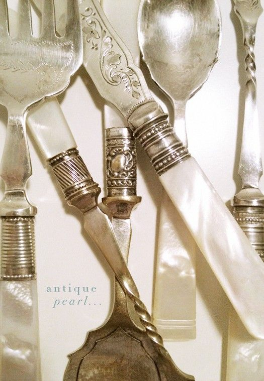 Antique silverware with mother-of-pearl handles.