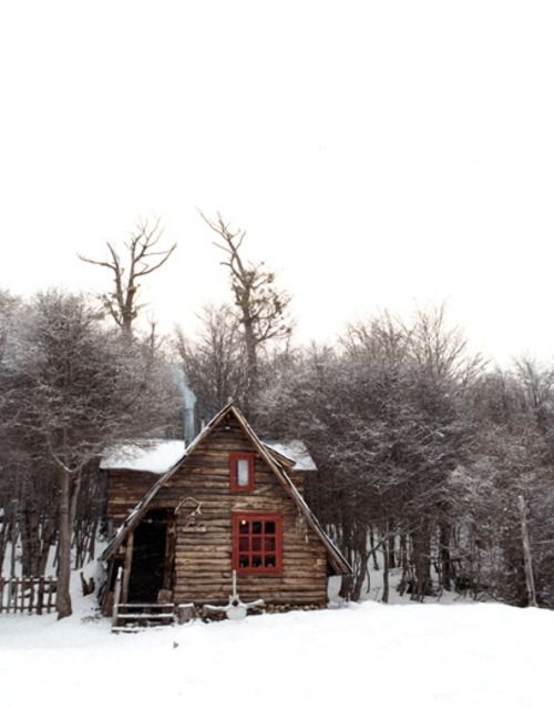 pitched roof, red windows, log cabin in snow