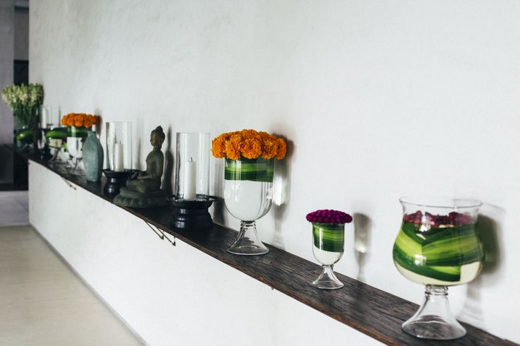 The Wall of the lobby with an assortment of vases.