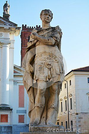 Marble statue and cathedral in Castelfranco Veneto, in Treviso, Italy.