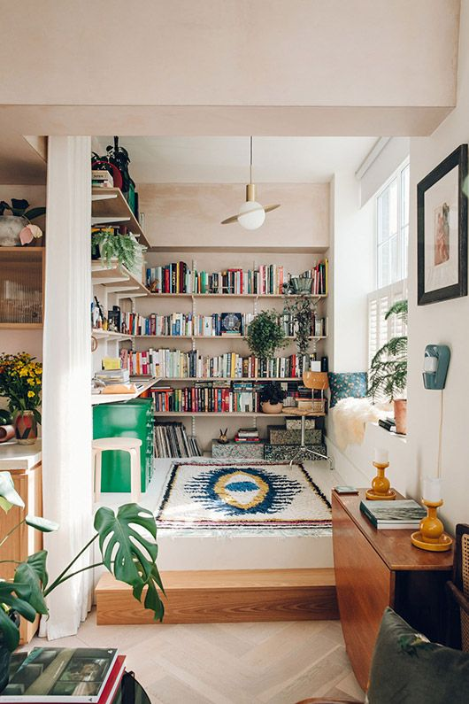 boho apartment with a beautiful living room we love these colorful shelves and the great boho rug