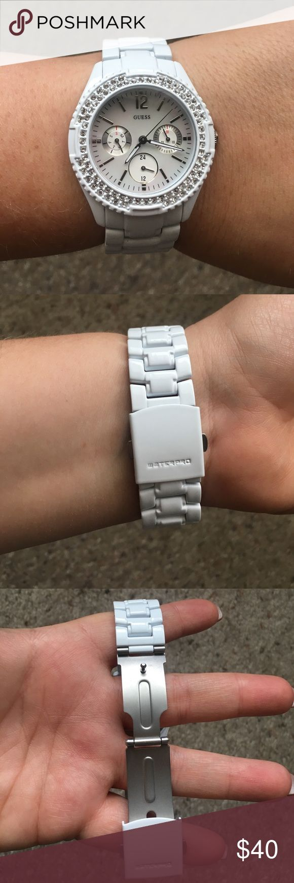 White Guess watch This Guess watch has a pearly iridescent face that also shows day of the week, the date, and the hour in military time. Needs new battery. Waterproof up to 330 feet. Guess Accessories Watches