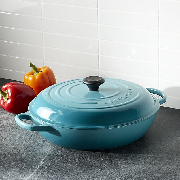 Revered by both professional chefs and home cooks since its 1925 debut, Le Creuset's classic French cookware is prized for its utilitarian good looks and unsurpassed heat retention. In a vibrant tropical blue, this cast iron braiser pan is clad in smooth, vitrified porcelain, rendering each piece impervious to acid, alkali, odors and stains. Designed with double handles for beautiful balance, the everyday pan lends itself to a variety of cooking methods for a wide range of meals.