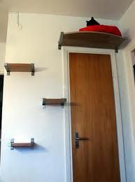 Cat perch - over laundry room/bathroom door? This is awesome! Love it!