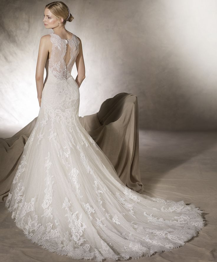 HUALCAN // Layers of embroidered tulle, lace and guipure craft a finely detailed mermaid wedding gown