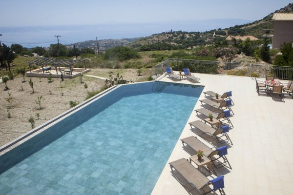 Reached by a steep driveway, the challenge is more than compensated for by the expansive infinity-edged swimming pool, sparkling like a rare gemstone, surrounded by a wide sun terrace and a view of Kefalonia and surrounding Greek islands, normally reserved for those with wings !
