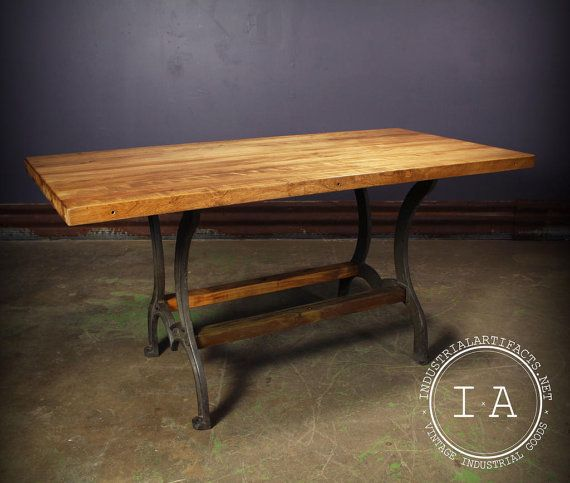 This vintage industrial kitchen table features a beautiful 60 x 29 1/2 top. The 1 1/2 thick butcher block table top rests on a pair of antique cast iron Price table legs. The Price stamp can be seen on both of the legs. The footprint of this table measures 36 x 22 1/2. The table stands 29 tall. Please take a close look at all of the photos. *THIS IS A LARGE ITEM THAT WILL NEED TO BE SHIPPED VIA FREIGHT. FREIGHT SHIPMENT RATES VARY DEPENDING ON THE BUYERS LOCATION, CONTACT OUR STAFF AT…