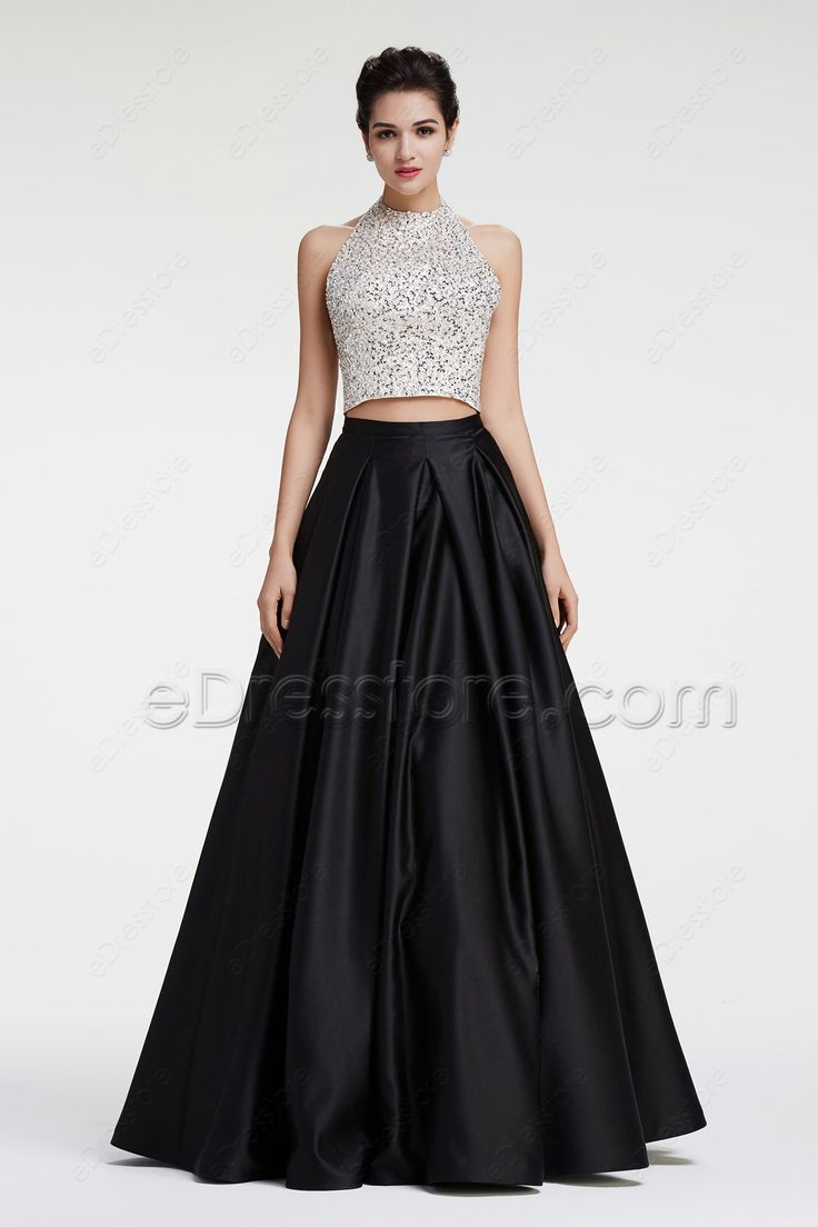The two pieces prom dress features halter neckline, white top with crystals and beadings, black ball gown skirt finishing with floor length.