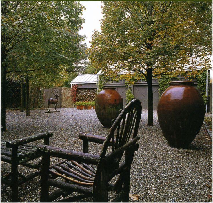 pea stone courtyard with urns  Dog Yard!