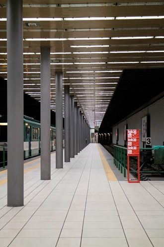 Empty Metro Station At Night #platform #building #billboard #urban #space #metro #connection #rapid #modern #line #background #metal #city #rail #architecture #blank #train #underground #road #business #terminal #street #copy #railroad #concept
