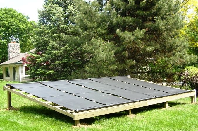 Solar Pool heating built on a ground rack. Solid, durable and low maintenance and out of the way.