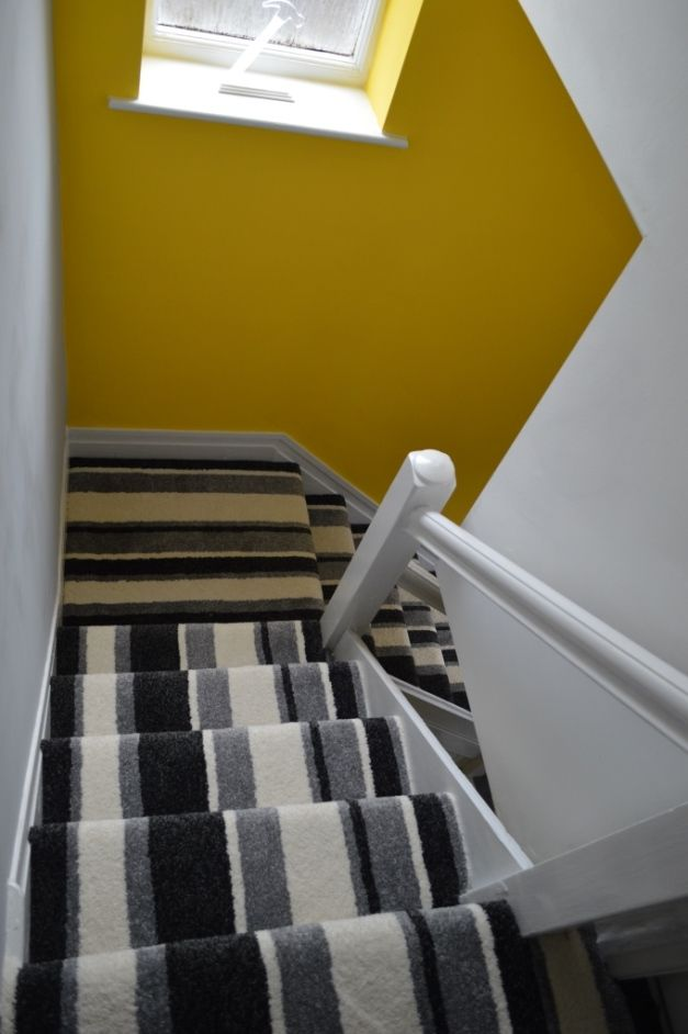 Hallway makeover. Painted in Valspar Oopsy Daisy. Monochrome stripe carpet on the stairs.