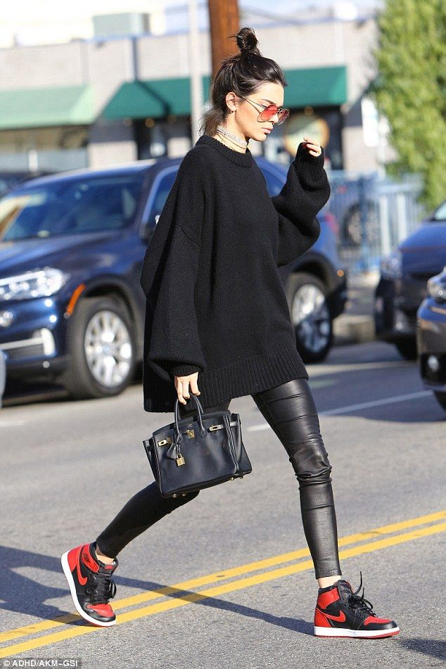 She's got the look: The 21-year-old model showed off her long legs in leather leggings...