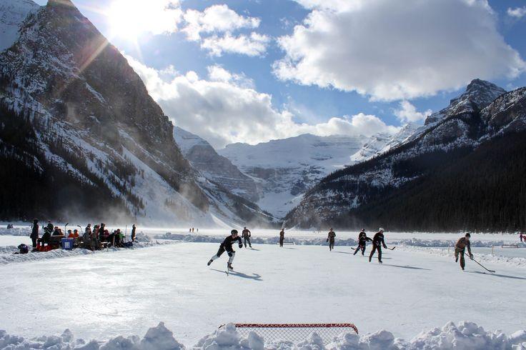 Rocky Mountain shinny - Canadian pond hockey on frozen Lake Louise, Canada. Fairmont Chateau Lake Louise hockey tournament - February.