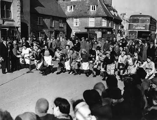 pancake race olney great british eccentricity,the race has been held since 1445...my question is if the diver in this double decker bus is taking part isn't that cheating,...old photo life