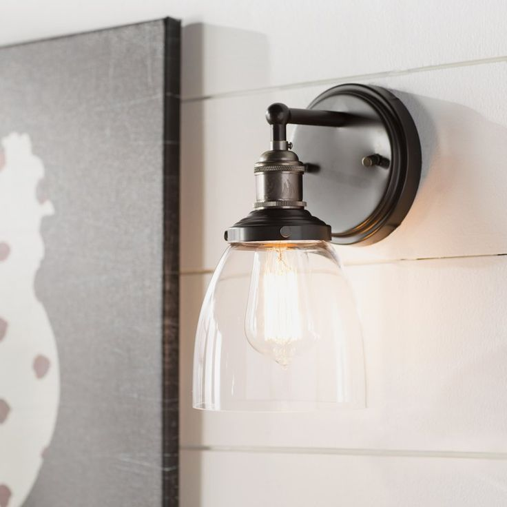 Sandy Springs 1-Light Farmhouse Wall Sconce - A versatile pick that can blend in with a variety of spaces, this chic wall sconce will bring style and a warm glow to any room in your home. Inspired by both rural barn designs and contemporary up…