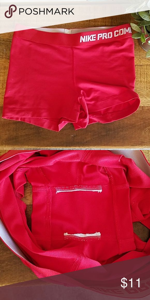 HOLD | Red NIKE Pro Combat shorts | dri-fit These are in used condition and picture 2 will show the inner strip cut out. The price reflects the nonperfect condition. Has some gym life left! Nike Shorts