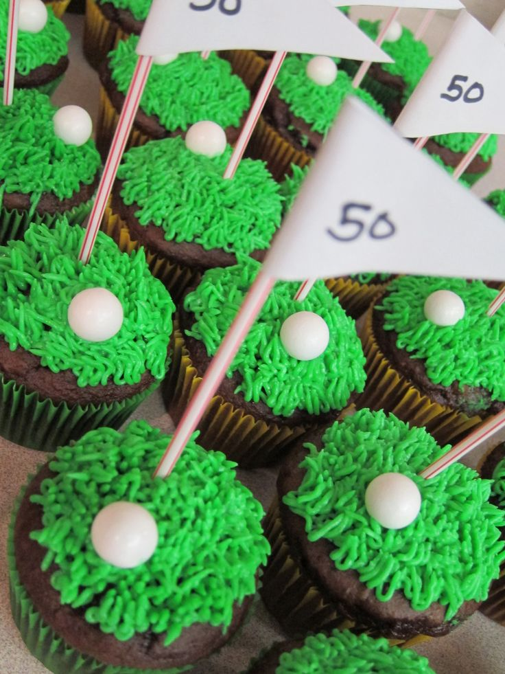 Golf Cupcakes - mini gumball golf balls, Wilton 233 tip for the grass, flags made from coffee stirrers and paper