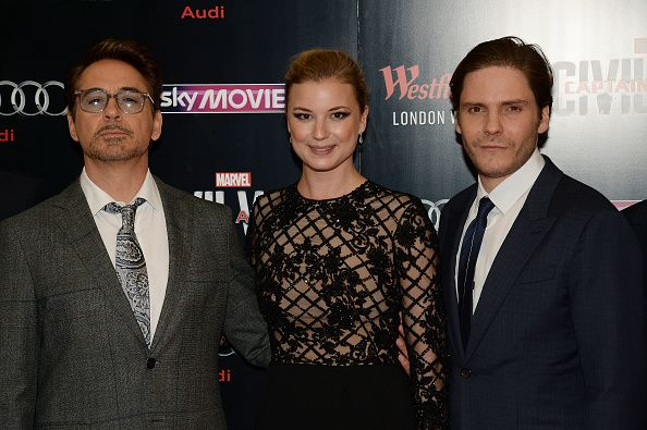 Robert Downey Jr Emily Vancamp and Daniel Bruhl pose for photos during the European film premiere of 'Captain America Civil War' at Vue Westfield on...