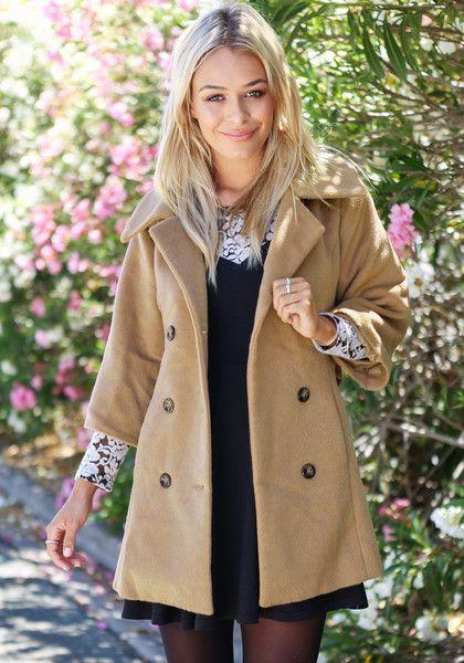 Beauty model in camel pea coat: