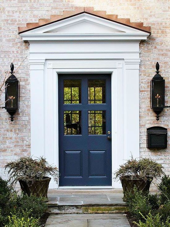 A navy blue door is a great way to add color without being too bold. See more spring home projects: http://www.bhg.com/homekeeping/house-cleaning/seasonal/spring-home-projects/?socsrc=bhgpin022113navydoor=5