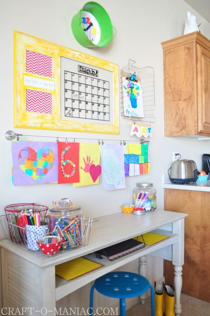 DIY Kids Art and Homework Station Basket on the wall...hanger for art. this looks just like my kitchen area set up. I may very likely replicate this - if not in the kitchen than certainly in the office or playroom. But this very convenient AND it's on the 1st floor!  Hmmm….