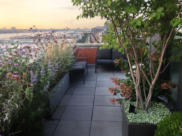 Tribeca roof garden patio with seating area over looking city.