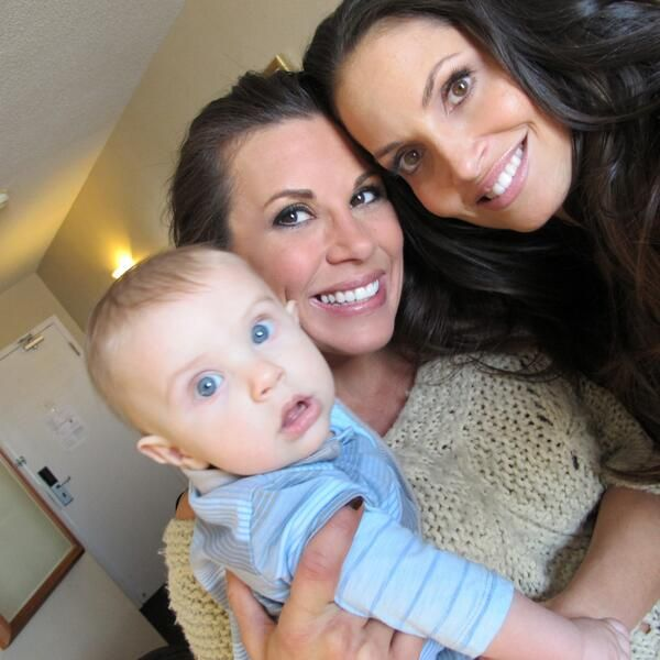 Mickie and Trish reunite in 2014 along with baby Max ...