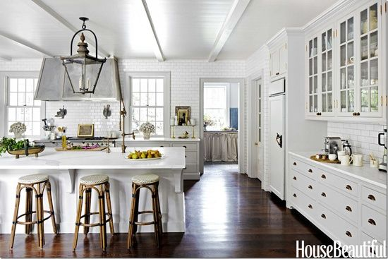 White kitchen, dark stained floors.